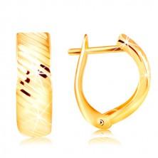 Orecchini in oro 14 - arco con intagli brillanti su diagonale