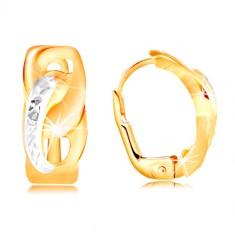 Orecchini in oro 585 - due ovali uniti, con piccoli tagli