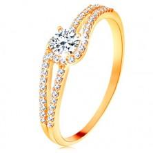 Anello d'oro 375 con i lati divisi brillanti, zircone chiaro