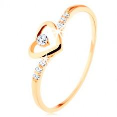 Anello d'oro 375, un contorno di un cuore con un piccolo zircone chiaro, lati ornati