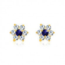 Orecchini in oro 585 - fiore in zircone chiaro con centro blu zaffiro, chiusura a perno